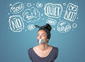 pic of taboo  - Young woman with taped mouth and white drawn thought clouds around her head - JPG