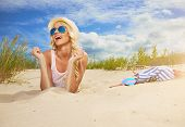 image of funky  - Beach woman funky happy and colorful wearing sunglasses and beach hat having summer fun during travel holidays vacation - JPG