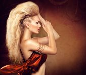 stock photo of blown-up  - High Fashion Model Girl with Mohawk hairstyle - JPG