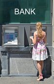 stock photo of automatic teller machine  - Girl at ATM - JPG