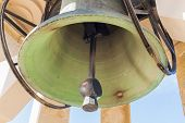 stock photo of battle  - Heavy steel bell at Maltese war memorial in memory of world war II battle for Malta - JPG