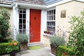 pic of charming  - Charming colorful front door entrance with blooming lavender in containers - JPG