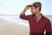 pic of beret  - handsome man wearing a beret on the beach - JPG