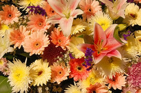 image of funeral  - mixed flowers in a wreath at a thai funeral - JPG