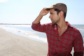 picture of beret  - handsome man wearing a beret on the beach - JPG