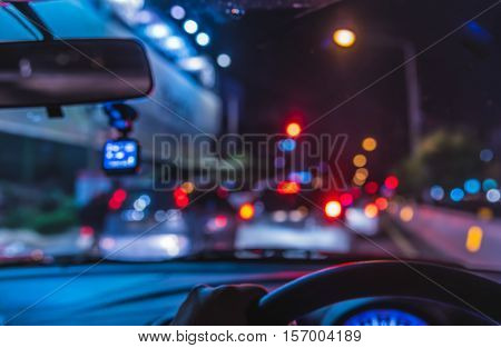 Vintage Tone Blur Image Of People Driving Car On Night Time .