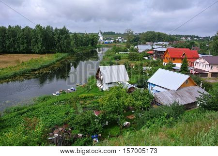 In bend of Kamenka River, opposite Suzdal Kremlin. Gold ring of Russia. Orthodox architecture
