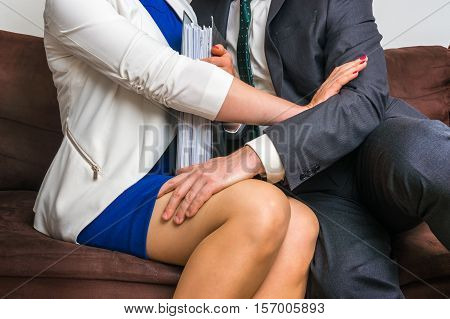 Man Touching Woman's Knee - Sexual Harassment In Office