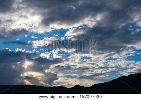 Mountain And Sunset Sky In Background.