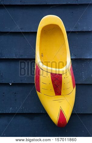 Bright yellow wooden clog, traditional Dutch shoes