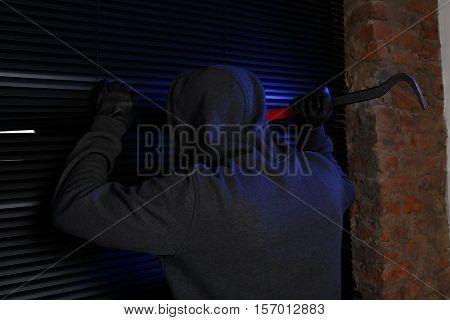 Night burglar trying open door