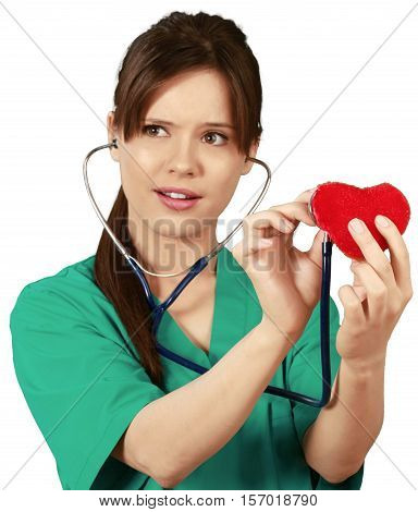 Female Cardiologist Examining a Toy Heart - Isolated