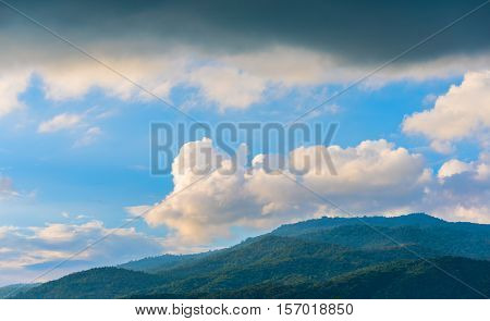 image of rainclouds and mountain in background at Doi Suthep Chiang MaiThailand.