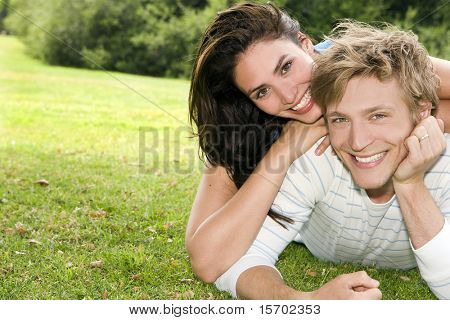 Happy young couple at a park