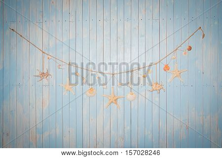 Colorful marine items on white painted wooden background. Sea objects on wooden planks. Selective focus. Place for text.