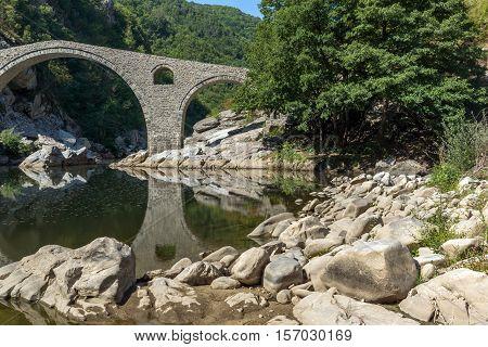Amazing Reflection of Devil's Bridge in Arda river and Rhodopes mountain, Kardzhali Region, Bulgaria