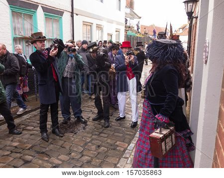 WHITBY ENGLAND - NOVEMBER 5: People taking photos of participants in Whitby Goth Weekend event. In Whitby North Yorkshire England. On 5th November 2016.
