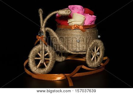 handmade decorative tricycle on a black background
