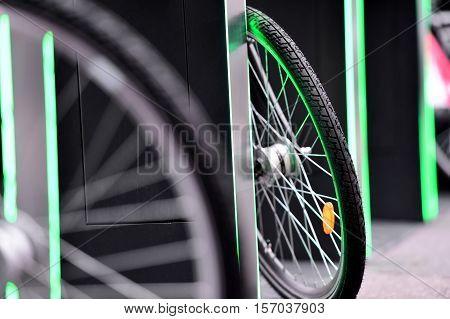 Detail with urban bicycle sharing system wheel detail