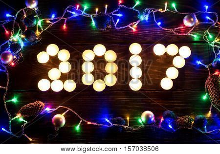 Happy New Year 2017 Written With Burning Candles