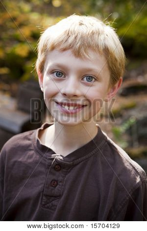 Portrait of a cute young boy outside