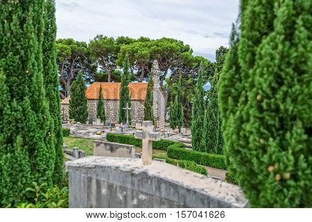 Virgin Mary church on graveyard in Tucepi, Croatia.