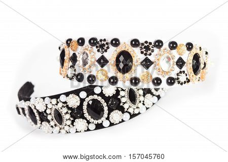 Three jewelry headbands for female hair on white, handmade