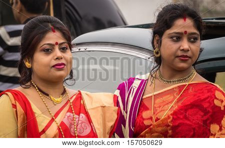 KOLKATA, INDIA - JANUARY 31, 2016: Indian married women dressed in traditional bengali outfits at the Statesman Vintage Car rally at the Fort William, Kolkata.