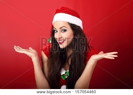 Confused Happy Emotional Woman Looking And Showing Wow Sign In Christmas Costume On Empty Copy Space