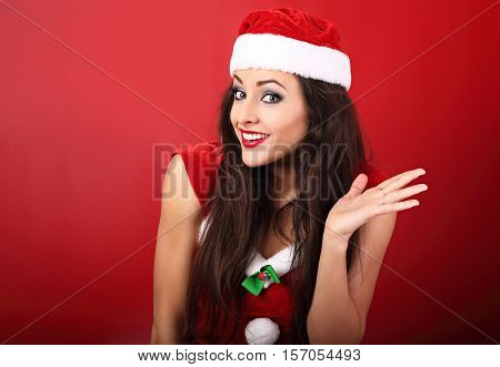 Confused Happy Emotional Woman Looking In Christmas Costume On Empty Copy Space Red Background