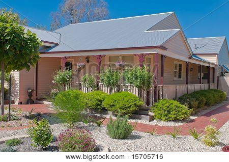 Pink Bungalow With The Stone Garden