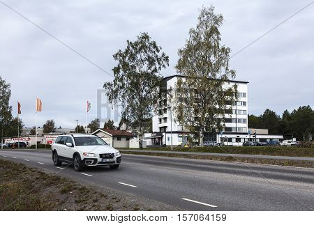 UMEA, SWEDEN ON AUGUST 30. View of a modern suburban settlement, cars, store on August 30, 2016 in Umea, Sweden. Street and car this side. Editorial use.