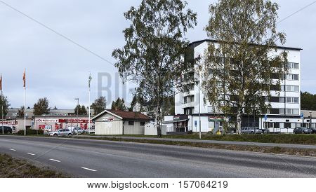 UMEA, SWEDEN ON AUGUST 30. View of a modern suburban settlement, cars, store on August 30, 2016 in Umea, Sweden. Street this side. Editorial use.