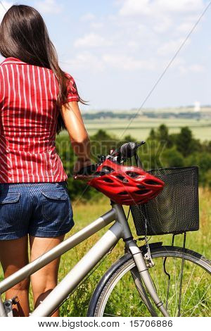 young female enjoying the view after a bike trip in Jutland, Denmark