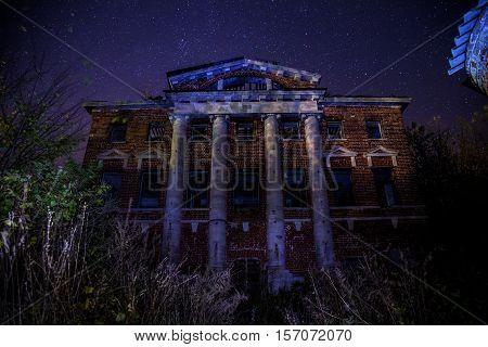 Ababdoned Kostrov's Manor at Kasimov, Ryazan region on background of starry night