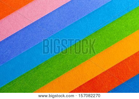 Background of colorful paper parallel diagonal stripes