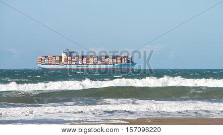 San Francisco CA - November 16 2016: Maersk cargo ship GUSTAV MAERSK entering the San Francisco Bay en route to the Port of Oakland. High tide and heavy surf.