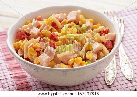 Salad with celery roots,corn, leek, pepper, ham and natural yogurt.