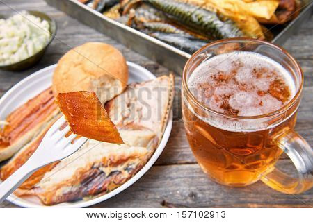 Meal consisting of smoked fish and beer