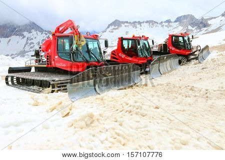 ZUGSPITZE GERMANY - JULY 5, 2016: The Pistenbully snowcats ready for ski slope maintenance in Zugspitze arena. Most famous ski resort in alps on Germany Austria border.