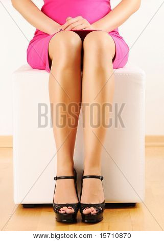 Woman with beautiful legs sitting