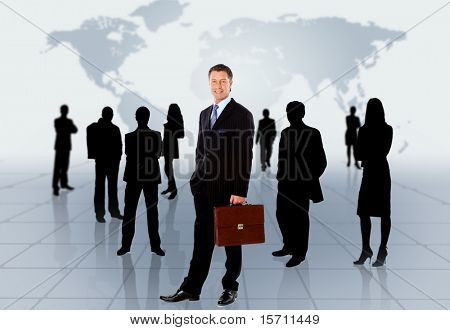 Businessman standing in front of an earth map