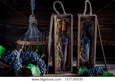 Fresh Red Wine In Wooden Box On Old Wooden Table