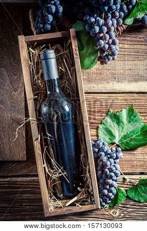 Fresh Wine In Bottle In Old Wooden Box