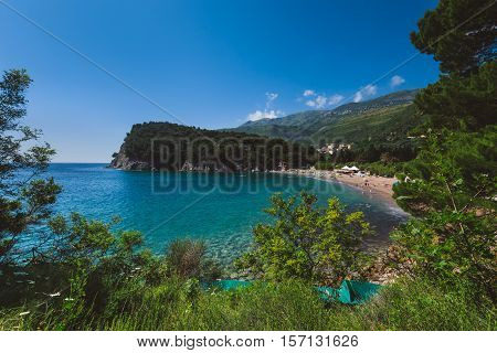 Lucice beach near Petrovac, Montenegro. Lucice - sandy beach on Montenegrin coast with clear water and pine trees around.