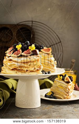 Mango and lemon curd crepe cake with whipped cream