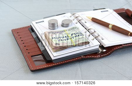 Concept of investment in a mutual fund with Indian currency, which is rupees.