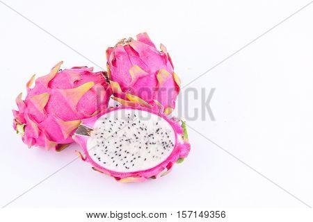 sliced  raw organic dragon fruit (dragonfruit) or pitaya on white background healthy dragon fruit food isolated