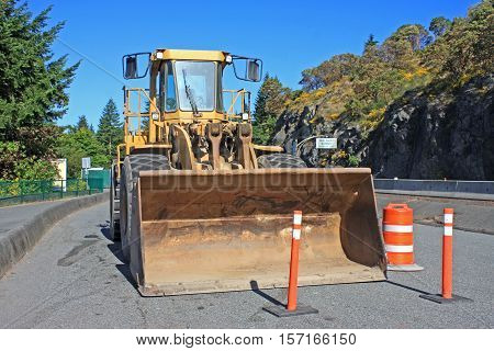 Bulldozer parked by the road side works