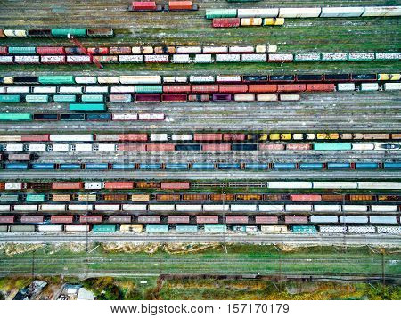 railway tracks and colorful wagons, top view, aerial shoot